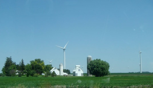 iowa farm with wind tower and traditional swedish painting on barn