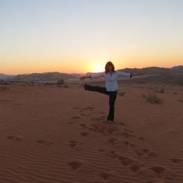 Eva doing yoga at sunset