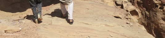 gold shoes and sandal close to petra cliff edge by evathedragon 2013